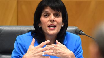 Julia Banks speaks to ANZ CEO Shayne Elliott during the House of Representatives Standing Committee on Economics annual public hearing at Parliament House in Canberra