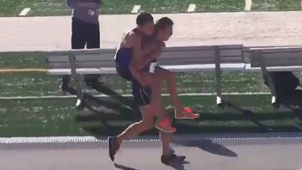 High school athlete carries injured teammate over the finish line