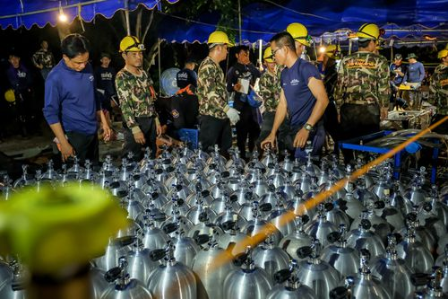 Scuba tanks are delivered to the site for the dive teams involved in the rescue coordination in Chiang Rai. (Getty)