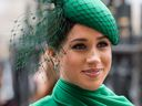 Meghan Markle dressed in green smiling