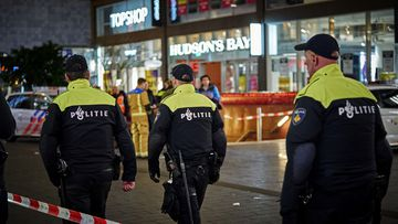 Dutch police secure a shopping street after a stabbing incident in the centre of The Hague, Netherlands, Friday, Nov. 29, 2019.