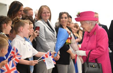 The Queen meets children in Cambridge.