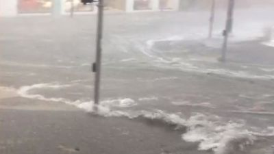 Water gushed along Brisbane streets and over the gutters. (Tobias Kelleher)