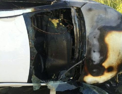 Not long after the officers pulled him out, flames filled the car. Picture: Supplied