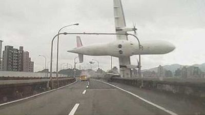 A video still captures the moment the plane banked sharply, clipping a moving taxi with its wing.