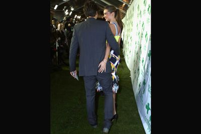 Trouble in paradise? Puh! Miranda gave Orlando's bum a playful squeeze at the Global Green USA pre-Oscar party, which they co-hosted together.<br/>