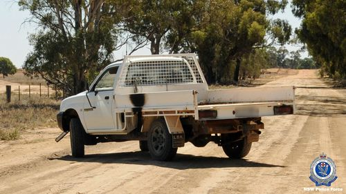 The white, single-cab Mitsubishi Triton used in the robbery. Detectives are appealing for dashcam footage of this vehicle driving in the Moama area.
