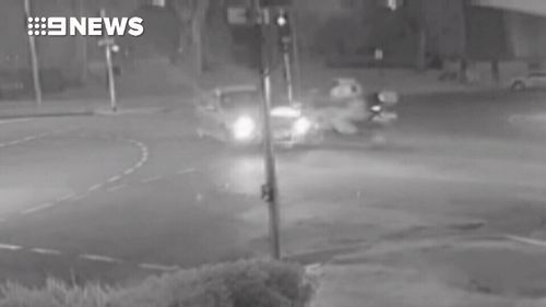 Ross is accused of slamming into the rider on Hutt Street in Adelaide in July.