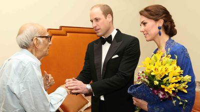 <p>The Duke and Duchess speak with Boman Kohinoor, who may be India's biggest fan of the British royal family, on day two of their tour. </p><p>His restaurant features giant cardboard cutouts of William and Kate, and he launched a campaign to meet them that trended on social media.</p>