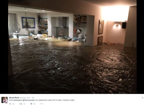 Stuart Rock said he heard the door bust and water quickly filled his basement flat. Source: Twitter