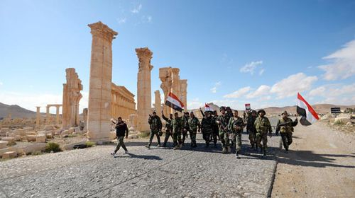 Syrian Army soldiers liberated Palmyra from ISIL on Sunday. (AAP)