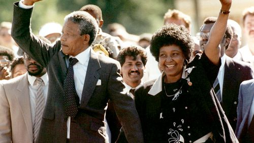 Nelson Mandela and wife Winnie, walk hand-in hand-with their raised clenched fists upon Mandela's release from Victor Verster prison in 1990. (AAP)