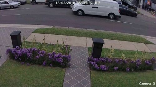 Security vision shows the family car pulling up as the girl waits on the side of the road. (Supplied)