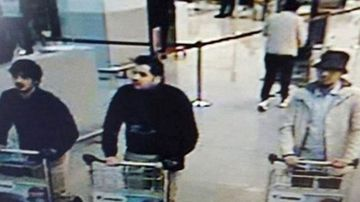 Three of the Brussels Aiport attackers, including Mohamed Abrini (left) in the moments before the attack.