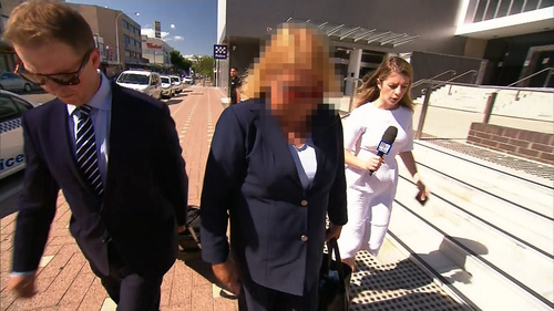 A Sydney teacher has faced court accused of grabbing, punching, scratching and pushing young students at a school in the city's south-west.