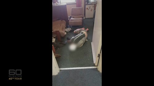 A student passed out drunk in the hallway. Picture: 60 Minutes