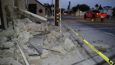 Rubble covers the sidewalk in front of the Vintners Collective multi-winery tasting room following an earthquake Sunday, Aug. 24, 2014, in Napa, Calif. (AAP)