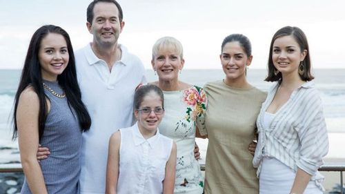 Andrew Wallace with his wife Leonie (right) and daughters including Caroline (left). (Photo: Supplied)