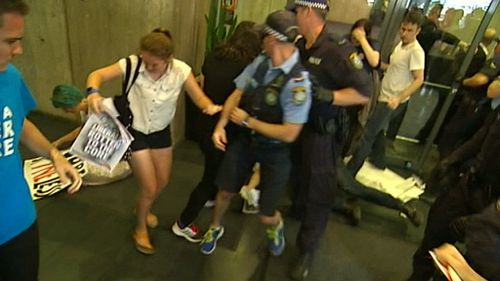 Police take one student from the scene. (9NEWS)