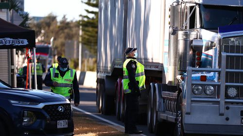 Queensland Police stop trucks at the Queensland border in Coolangatta.