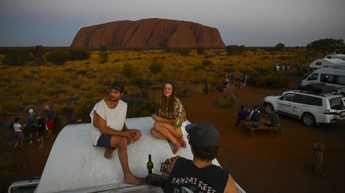 Most visitors to Uluru are happy not to climb the big rock.