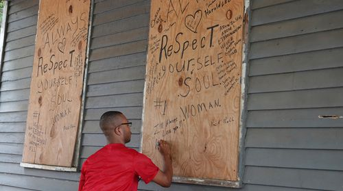 A fan leaves flowers and expresses his love at the home where Aretha Louise Franklin was born on March 25, 1942 in Memphis.