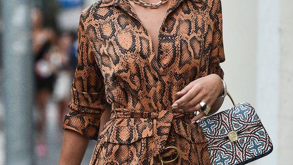 Stylish woman wearing dress and handbag