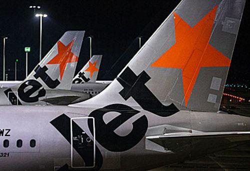 Jetstar passenger jet tails (Getty)