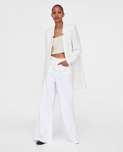 "<a href=""https://www.zara.com/au/en/textured-weave-coat-p02706607.html?v1=6295579&v2=1009742"" target=""_blank"">Zara Textured Weave Coat in Ecru, $139</a>"