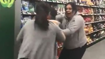 A mother and daughter jostled with another shopper at the Chullora Woolworths.