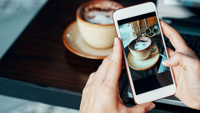 International data roaming woman taking photo of coffee