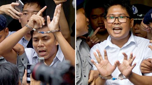 Reuters journalists Kyaw Soe Oo, left, and Wa Lone, are handcuffed as they are escorted by police out of a court in Yangon, Myanmar.