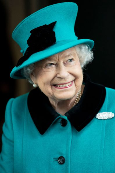 Queen Elizabeth II wearing green outfit