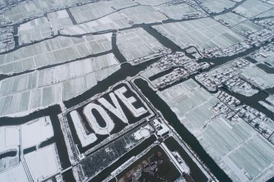An aerial view of a pattern reading 'love' after snow at Baidian county in Hai'an city, east China's Jiangsu province.