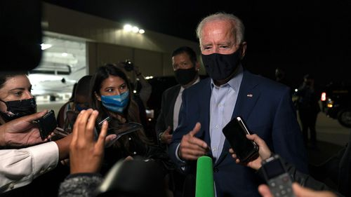 Joe Biden answers questions from reporters at New Castle Airport in Delaware.
