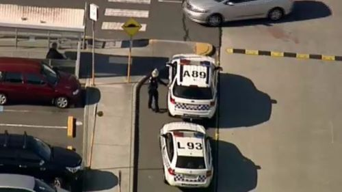Police at the scene outside the centre on Jacksons and Police Roads. (9NEWS)