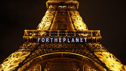 195 nations agree to fight global warming and reduce emissions in historic Paris pact