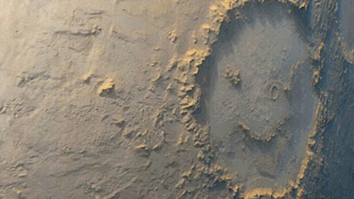 The famous Galle crater on Mars looks like a smiley face. (AAP)