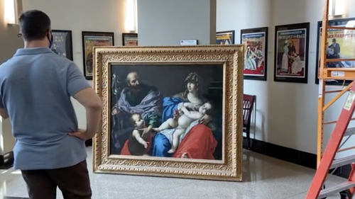 Tom Ruggio immediately started taking photos of the painting for identification.