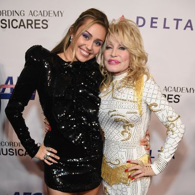 Miley Cyrus and godmother Dolly Parton