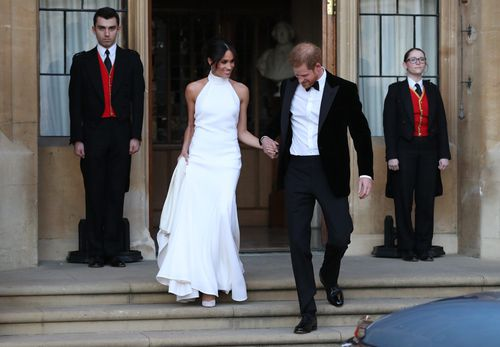 The newly married couple leave Windsor Castle after their wedding to attend an evening reception at Frogmore House, hosted by the Prince of Wales. Picture: PA