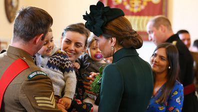 The admittedly 'broody' Duchess greeted a toddler at the celebration.