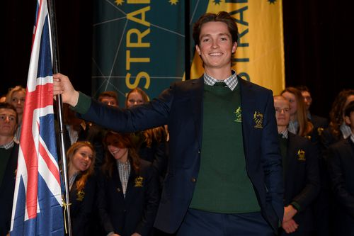 James poses for a photograph with the Australian flag after being announced as the team flag bearer. (AAP)