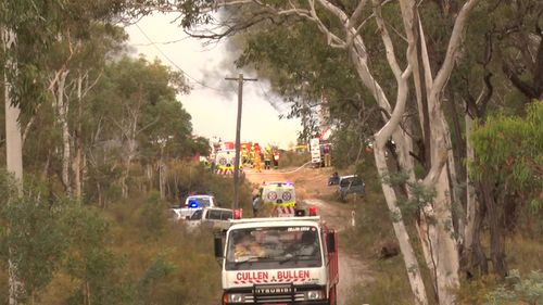 Two adults and two children escaped the blaze, with one woman being treated for burns to her hip.