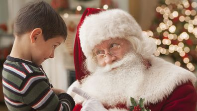 Child with Santa Claus (Brand X Pictures/Getty Images)