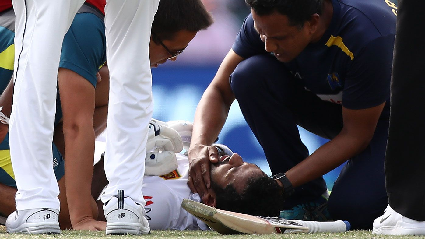 Sri Lankan opener Dimuth Karunaratne rushed to hospital after being hit by a vicious bouncer