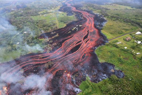 Thick lava flows from the volcano eruption are leaving gaping black scars across the countryside in Pahoa. (AAP)