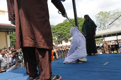 World News: Indonesian teenage couple caned for public affection