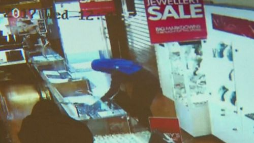 Masked men stormed the Elsternwick shop, smashing the cabinets with hammers. (9NEWS)