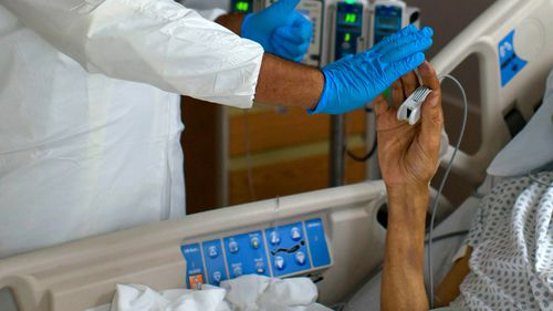 Australia suffers worst day yet in pandemic as 10 die of coronavirus